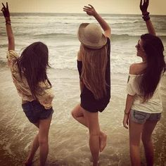 Hestia Jones, Marlene McKinnon and Emmeline Vance letting loose at the beach. Taken by Lily Evans. Summer 1977.