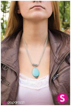 Weeping Rock ~ A smooth turquoise stone in the shape of a teardrop swings delicately from an antiqued silver fixture that has been threaded along three strands of silver chain. Features an adjustable clasp closure.