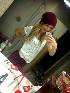 I love her hat and shirt plus she's beautiful