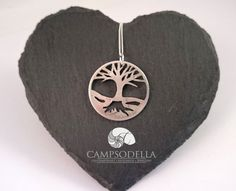 This Tree of life pendant has been made to show the beautiful detail of the Victorian coin and has two very different sides. One side willowy and