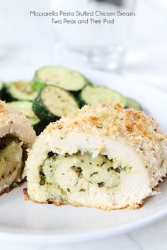 Mozzarella Pesto Stuffed Chicken Breasts Recipe on http://twopeasandtheirpod.com Baked chicken with a cheesy pesto filling and a panko parmesan crust!