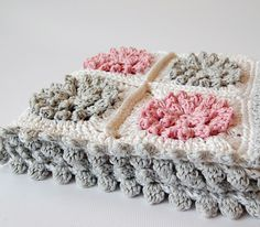 Pink and grey - squares for baby blankets, cushions, throws, bedspreads... Free crochet patterns ( links to squares + border designs via this site )
