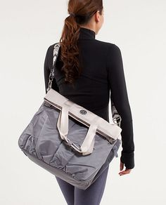 Flow and Go Tote from lululemon. A tote bag OR a messenger bag...and it has a special spot for your yoga mat!  NEED.