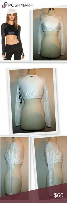 Koral Activewear Levitate Crop Top in White Koral Activewear Levitate Crop Top.  Crew neck.  Shiny panel with long raglan mesh sleeves. Thumbholes. Elastic band. This was a designer sample, so there are no label inside the top.  Body 87.5% polyamide 11.5% lycra  Sleeves 85% polyamide 15% lycra  These were purchased directly from the brand. No trades. Lowball offers will be declined. Koral is a high end activewear line sold at Neiman Marcus, Saks Fifth Avenue and Bloomingdale's. Koral…