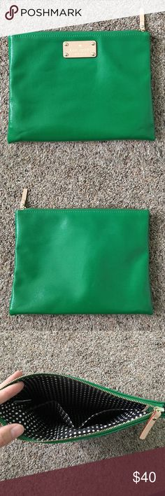 """Kate Spade Clutch Green Kate Spade clutch with adorable polka dot lining.  2 pockets on inside.  3 faint, tiny marks on front. 9.5"""" x 7.25"""" kate spade Bags Clutches & Wristlets"""