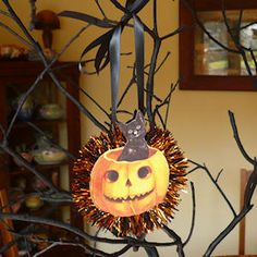 """Here is a simple Halloween Pumpkin Ornament craft with a surprise - a black cat popping out to say """"boo!"""""""