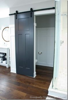 Barn door in master bathroom renovation