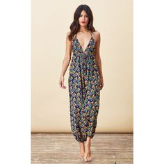 Dancing Leopard Genie Jumpsuit in Pineapple Print ($50) ❤ liked on Polyvore featuring jumpsuits, multicolour, holiday jumpsuits, drawstring jumpsuit, pineapple jumpsuit, pink jumpsuit and loose jumpsuit