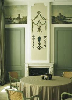 Dining room fireplace green woodwork round table