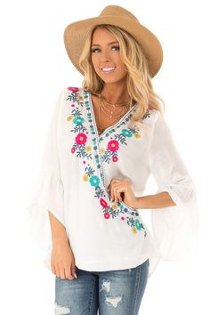 74b2fb2b4c9c2b Off White Surplice Top with Floral Embroidery and 3/4 Sleeves front close  up Ladder