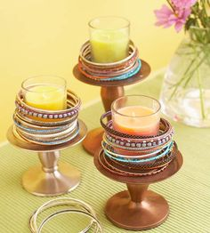 Add sparkle to glass votive holders by stacking bracelets on footed candleholders. Vary the colors and styles of the bracelets for an eclectic look. For safety, use only votive candles in glass holders.