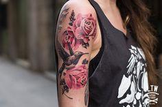 Sweet rose/bird female tattoo