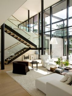 Contemporary loft with huge floor-to-ceiling windows and a simplistic staircase