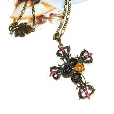 Only $10.99! - Black, Gunmetal, Yellow, Copper Metallic Rose Bronze Cathedral Cross Pendant Necklace with Bright Pink Rhinestones - FREE USA SHIPPING - Gothic Rose Cross Necklace/ Metallic Rose Bronze Cross Pendant/ Under $15 Cross Necklace/  Day of the Dead Cross Necklace / Pin Up Cross / Rockabilly Necklace   https://www.etsy.com/listing/467390979/blackgunmetalyellowcopper-metallic-rose
