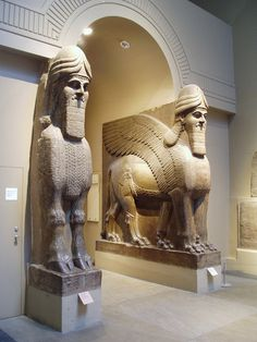Nimrud Palace Gate. Winged human-headed bulls, the powerful guardians of ancient Assyrian gateways, serving such a purpose for the royal plalace of Nimrud (near Mosul in modern Iraq). and set in a sympathetic reconstruction at the British Museum.