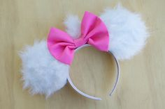 These Marie Aristocats Minnie Mouse Ears are the perfect accessories for those exciting fun filled Disneyland Trips! Ears are made of White Fur Fabric, Bow is made of Pink Cotton attached to a white satin headband. ***This is a MADE TO ORDER item. So Please allow 1 to 2 weeks for me
