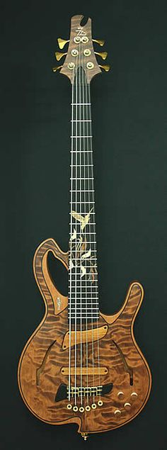 Barcelona 6-string bass. Whoa. I don't usually go for the quilted maple, but damn.