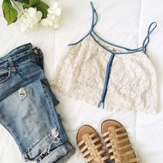 SOLDDenim and Lace Crop Tank/Bralette Adorable and sweet crop tank/bralette style top. Denim and cream lace. Button front detailing. With shelf bra. PERFECT FOR FESTIVAL WEAR  Tops Crop Tops