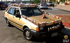 How do you make sure no one parks too close to you? Glue a ton of troll dolls on your car, thats how.