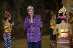 Oct. 7, 2013. U.S. Secretary of State John Kerry, wearing 'endek', a traditional Balinese woven fabric, poses upon arrival for a dinner for leaders of the Asia-Pacific Economic Cooperation (APEC) forum in Bali, Indonesia.