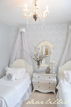 Dear Lillie: The wall color in that room is a beautiful gray from Benjamin Moore, called Pebble Beach. four $8 rolls of this damask wallpaper Cornices/crowns were shelves from Hobby Lobby for $12 a piece. used a $7 a yard swiss dot sheer fabric to make the draping from them.