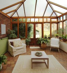 Sunroom with terracotta floor tiles and cathedral ceiling with frosted glass