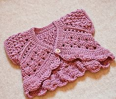 Butterfly shrug, up to age 5-6 but larger sizes are likely to need more yarn. Crochet in DK.