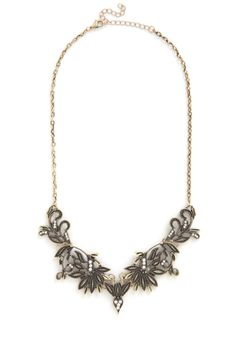 Enchanted Oasis Necklace. Like a princess wandering through an expanse of wildflowers, you mingle amidst the partys eclectic scene wearing the budding filigree of this statement necklace. #gold #modcloth