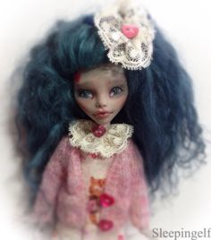 Zombi gets a new look ..and she loves it She really isn't into this undead stuff She likes lace and knitting and flowers ...and kitty's ...oh dear she isn't a very good evil creature of the night