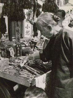 Selling lap cheong (Chinese sausage) in Singapore Chinatown, 1954.   THE LIBYAN Esther Kofod www.estherkofod.com