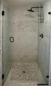 Shower door opens inward to save space in bathroom