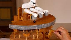 Manually Cranked Wood Toy Performs Sleight of hand Magic wood magic kinetic automata