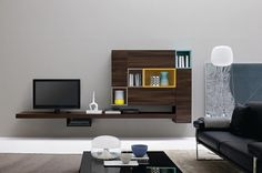 Modern Living Room Wall Units With Storage Inspiration | If you prefer a contemporary look to your living room, then storage furniture with a clean uncomplicated line is essential. | www.bocadolobo.com #homefurnitureideas #homefurniture