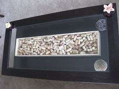 Wine theme wedding guest book. Have your guests sign wine corks and then put them in a shadow box