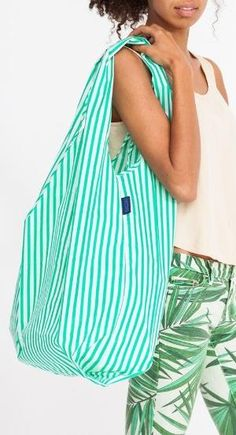 This carryall tote not only looks chic, but is environmentally friendly. by nichole