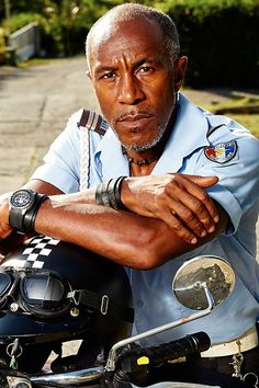 . Actor Danny John Jules as Officer Dwayne Myers.  If you like detective shows with a twist of humor set in the Caribbean... You would like Death in Paradise!