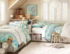 This space has room for two! Beautiful sand colored walls and off white furniture, are easy to the eye with the light blue bedding