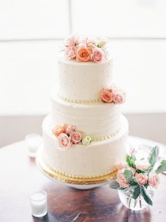 Floral topped three-tiered wedding cake: http://www.stylemepretty.com/missouri-weddings/st-louis/2015/12/14/st-louis-secret-garden-wedding-at-kuhs-farm/ | Photography: Jordan Brittley - http://jordanbrittley.com/