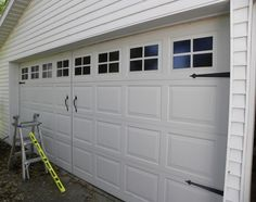 Painted Faux Garage Windows -- looks just like a carriage garage door - add hardware and voila you have an upscale look with tons of curb appeal I am so doing this!!!