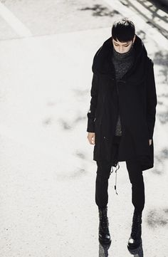 Grey fleck jumper / jersey + black hooded coat + jeans + lace up boots