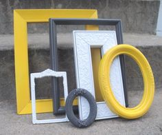DIY - Find inexpensive frames with good shape and texture. Create a color palette (like this awesome grey, yellow, white) and paint them. Create a gallery wall or simply layer the frames as wall decor. Spray Paint Frames, Painted Frames, Home Projects, Craft Projects, Mellow Yellow, Grey Yellow, Home And Deco, My Living Room, Home Remodeling