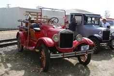 Vintage Ford fire truck. Wooden spoke wheels even.
