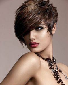 A pixie haircut is a short haircut with layers. It is styled to be close to the head. A special feature of the pixie haircut is hair cropped close to the face and sides and back of the head, in layers. This is the cutest short hair cut. Pixie Cuts, Short Hair Cuts, Short Hair Styles, Short Pixie, Asymmetrical Pixie, Asymmetrical Hairstyles, Edgy Pixie, Curly Pixie, Asymmetric Hair