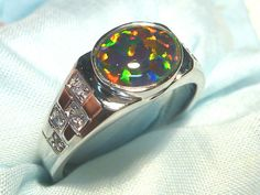 Mens Opal Ring  Sterling Silver, Lab Created 10x8 mm Oval Triplet. item 40814.