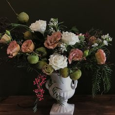 Flowers and Fruit Urn Arrangement with pomegranate, lisanthus, pink pepper, tweedia and roses Floral Wedding, Wedding Flowers, Order Flowers Online, Sympathy Flowers, Vase Arrangements, Floral Foam, Flower Delivery, Urn, Pomegranate