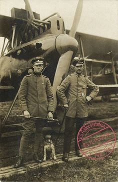A German pilot with his observer/gunner and a dog.