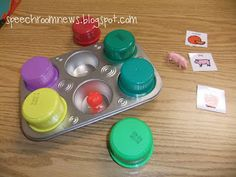 All you need is a muffin tin and some laundry detergent lids.  Fill the tins with miniature objects and then make  symbols for each one. There are tons of ways to use this for both articulation and language. When I take it to preschool I can make it work for my everyone I see that day!! Something about 'finding' and item is just way more fun!