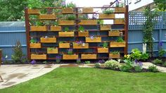 love this idea for a privacy screen, but who will take care of the flowers? and then clean it all up? My gardener?
