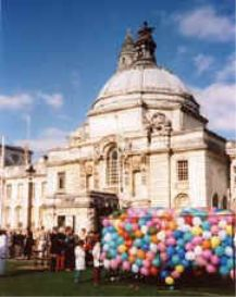 Cara E. Moore is a writer and poet who has written travel article and collections of poetry. This photo is Cardiff Wales, with balloons to be released at a start of a charity race.