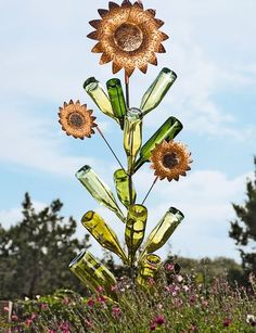 Gorgeous garden art - Add a festive finish to your bottle tree with these handcrafted sunflowers. Made from copper-colored, powder-coated steel, they complement the colorful bottles and add even more brilliance when the sun glints off the shiny finish.